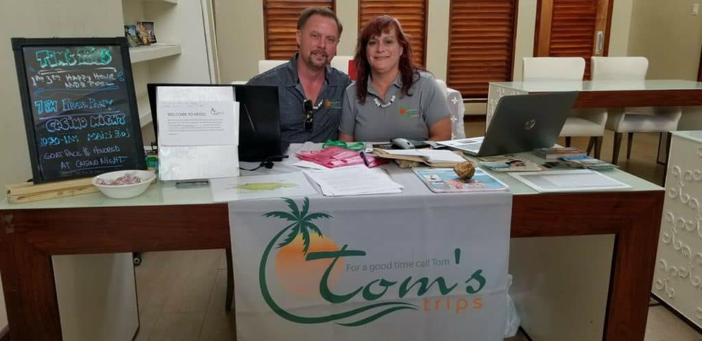 Tom and Bunny at the Host Welcome Desk at Toms Trips Hedonism group trips to check couples in